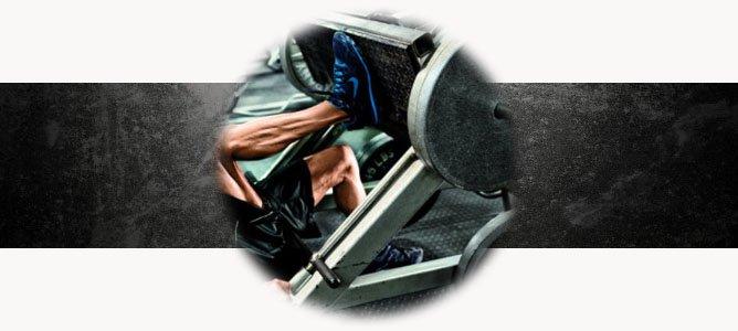Жим ногами в тренажере лежа или сидя